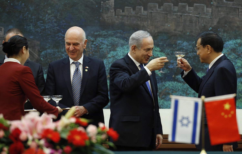 נתניהו וראש ממשלת סין. מדינת ישראל כבר לא מסוגלת לראות את הפרצוף האמיתי של המפלגה הקומוניסטית | תמונה: Kim Kyung-Hoon-Pool/Getty Images